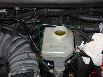 Top Up The Reservoir With New Clean Fluid